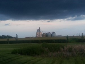 a midwestern field with a rusted-out grain elevator